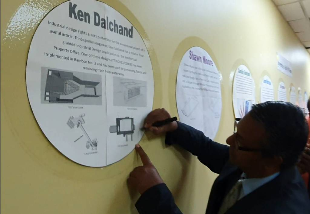 Mr Ken Dalchand signing the image of his Invention in the Hall of Fame